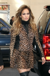 Jennifer Lopez wears a daring leopard print dress with knee high boots as she steps out in New York City