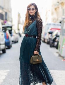 PARIS, FRANCE - SEPTEMBER 28: Doina Ciobanu wearing a green dress, sheer top, Louis Vuitton bag outside Dries van Noten on September 28, 2016 in Paris, France. (Photo by Christian Vierig/Getty Images)