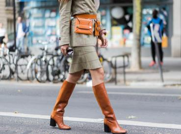 PARIS, FRANCE - JUNE 25: Doina Ciobanu wearing Stella McCartney belt bag, brown boots, checked skirt and blazer outside Paul Smith during Paris Fashion Week Menswear Spring/Summer 2018 Day Five on June 25, 2017 in Paris, France. (Photo by Christian Vierig/Getty Images)